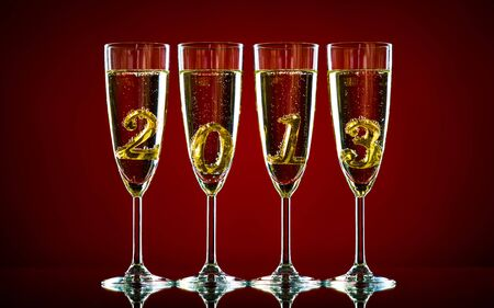 four glass goblet with champagne and  numeral 2013,  beautiful celebrations  New Year concept photo photo