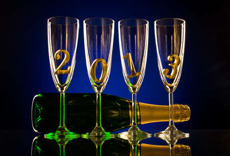 bottle  champagne with four glass goblet and  numeral 2013,  beautiful celebrations  New Year concept photo Stock Photo - 16261174