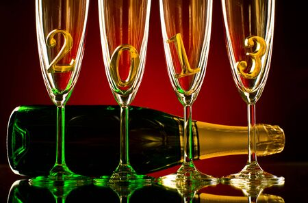 bottle  champagne with four glass goblet and  numeral 2013,  beautiful celebrations  New Year concept photo Stock Photo - 16261178