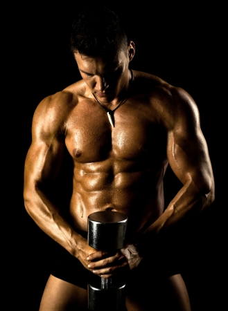 powerful man: very power athletic guy ,  execute exercise with  dumbbells, on bkack background Stock Photo