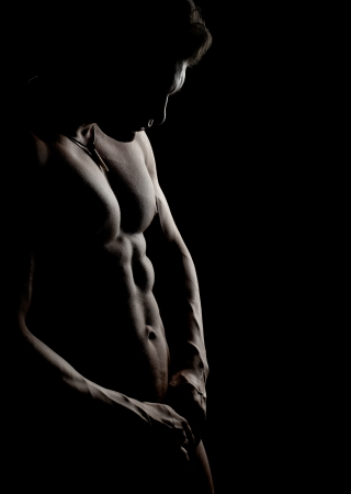 naked man: the very muscular handsome sexy guy on black background, naked  torso