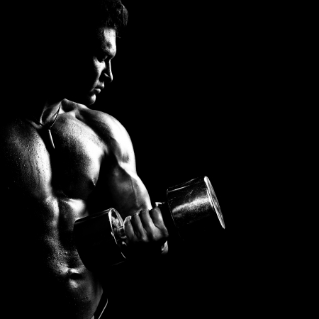 bodybuilder man: very power athletic guy ,  execute exercise with  dumbbells, on bkack background, black-and-white