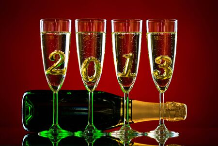 bottle  champagne with four glass goblet and  numeral 2013,  beautiful celebrations  New Year concept picture photo