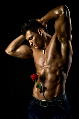 the very muscular handsome sexy guy on black background, naked  torso Stock Photo - 16574523