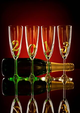 bottle  champagne with four glass goblet and  numeral 2013,  beautiful celebrations  New Year concept photo Stock Photo - 16713154