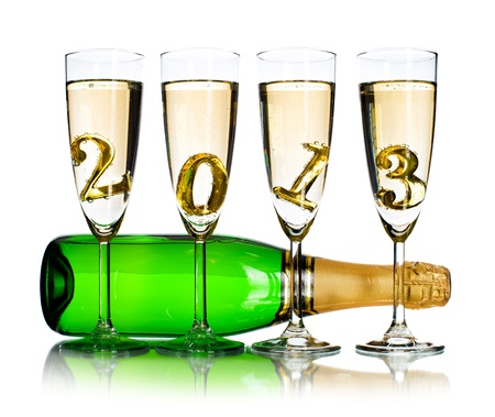bottle  champagne with four glass goblet and  numeral 2013,  beautiful celebrations  New Year concept photo,  on white background; isolated photo