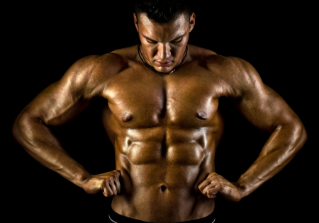 the very muscular handsome sexy guy on black background, naked  torso Stock Photo - 16711237