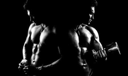 musculation: very power athletic guy ,  execute exercise with  dumbbells, on bkack background, black-and-white
