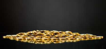 encash: still life of very many placer gold  monetary or change coin, on dark  background