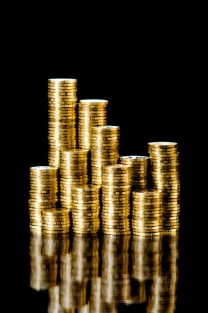 encash: still life of very many rouleau gold  monetary or change coin, on black background Stock Photo