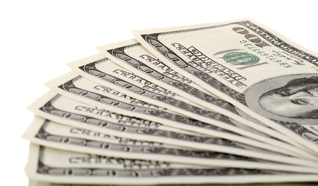encash: background of many mass currency note  US dollars, close up on white background, isolated Stock Photo