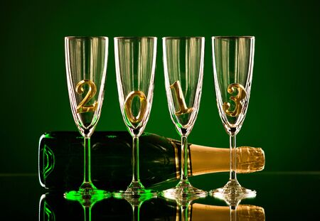 bottle  champagne with four glass goblet and  numeral 2013,  beautiful celebrations  New Year concept photo Stock Photo - 16713153