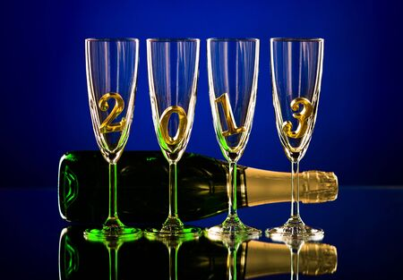 bottle  champagne with four glass goblet and  numeral 2013,  beautiful celebrations  New Year concept photo Stock Photo - 16713149
