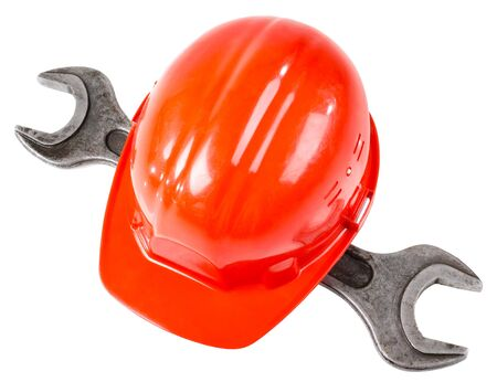 implements: photo  red  safety cap and steel  wrench, close up on white background, full face