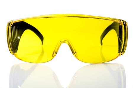photo  yellow protective spectacles on white background isolated, close up full face Stock Photo - 16929495