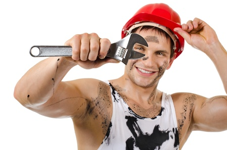 the beauty worker  man, dirty in  safety helmet  with big wrench  in hands, turn on and smile, on white background, isolated photo