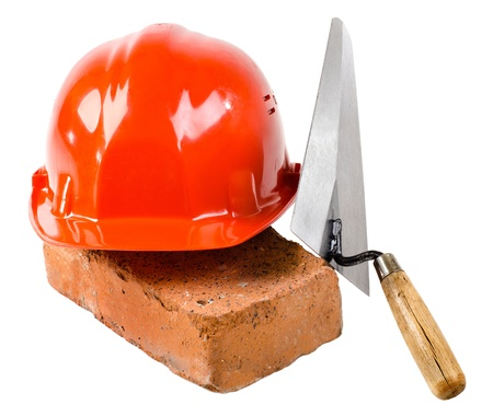photo  beauty red  safety cap and  brick with  plane, close up on white background, isolated photo