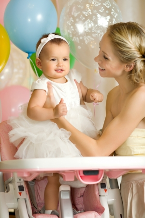 mammy: one-year-old little girl with  mammy, happy family
