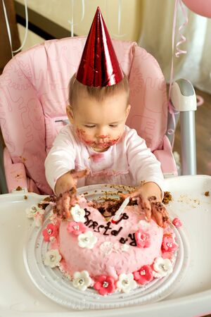 one-year-old little girl with  dirty-faced solemnize birthday  Stock Photo - 17221583