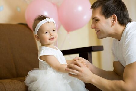 the happy little baby girl smile with daddy, indoor Stock Photo - 17203872