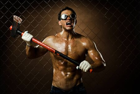 evildoer: crazy frenzied chopper  butcher man covered with blood,  action with big axe  Stock Photo