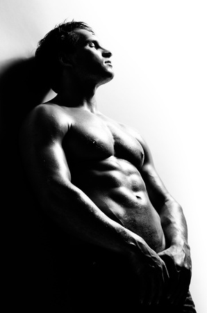 the very muscular handsome sexy guy ,  black-and-white  photo