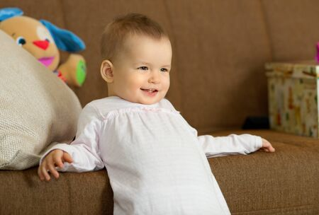 the happy little baby girl smile , in home interior Stock Photo - 17221579