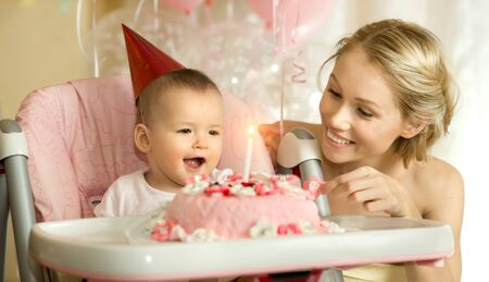 one-year-old little girl with  mammy solemnize birthday, happy laughter Stock Photo - 17221590