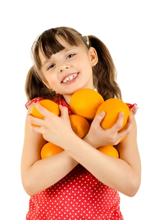 beauty little girl hold many orange and smile, on white background, isolated photo