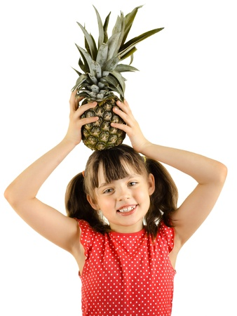 bawl: happy beauty little girl, hold pineapple and smile, on white background, isolated Stock Photo