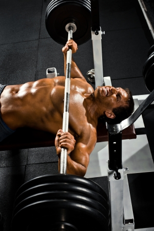 bodybuilder man: very power athletic guy ,  execute exercise press with weight, in sport hall