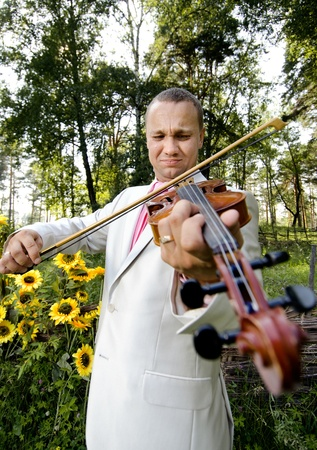 young fellow: guy bridegroom play on  violin , in wedded day Stock Photo
