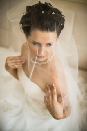 vertical wedding portrait beautifull  fiancee in white dress, soft light photo