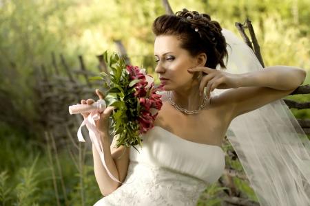 fiancee: horizontal wedding portrait beautiful  fiancee with  bouquet  in white dress, soft light