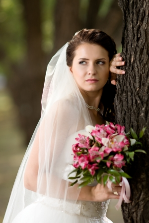 fiancee: vertical wedding portrait beautiful  fiancee with  bouquet  in white dress
