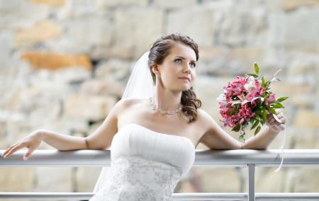 fiancee: horizontal wedding portrait beautiful  fiancee with  bouquet  in white dress