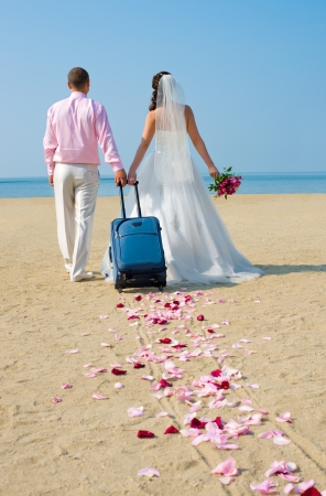 happy newly married couple to go  on a honeymoon ,  on  sea  photo