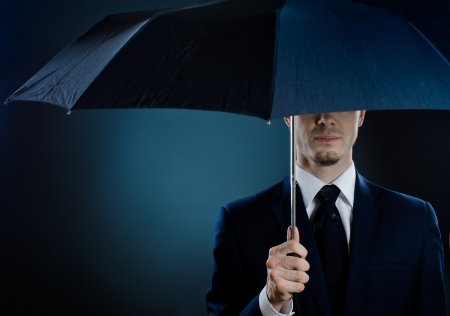 rigorous: portrait  man the  beautiful  man in blue costume with umbrella,  special-service agent  Stock Photo