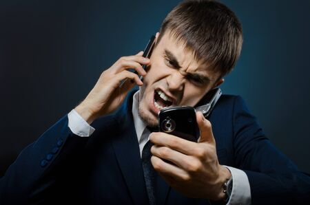 deplorable: closeup portrait  the  beautiful  businessman careerist in costume,  call and angry cry Stock Photo