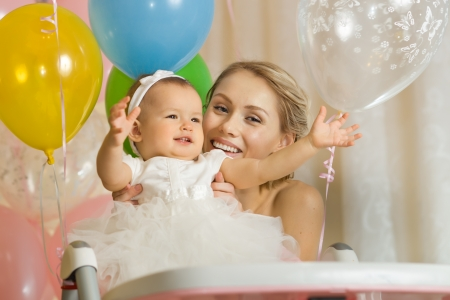 one-year-old little girl with  mammy, happy family, horizontal photo Stock Photo - 18205367