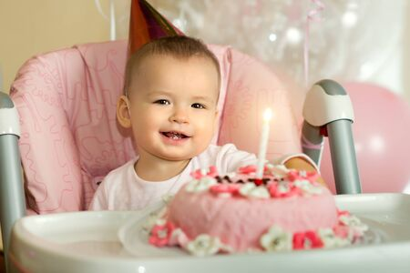 one-year-old little girl solemnize birthday, happy laughter, horizontal photo Stock Photo - 18205311