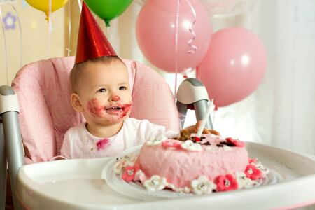 one-year-old little girl solemnize birthday, happy laughter, horizontal photo Stock Photo - 18205461