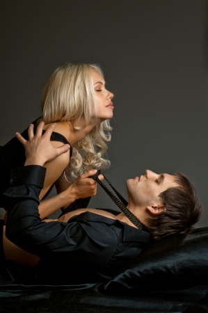 men sex: muscular handsome sexy guy with pretty woman, on dark background Stock Photo