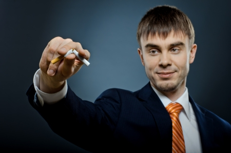 portrait the businessman in costume give up cigarette and  break ,  no smoking - concept photo