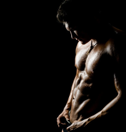 naked black men: the very muscular handsome sexy guy on black background Stock Photo