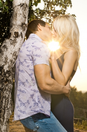 romantic evening date on nature, couple  embrace on beautiful sunset Reklamní fotografie - 18353013