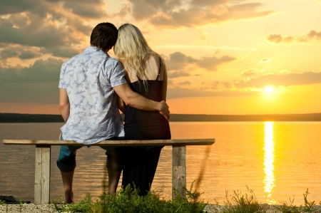 happy  couple, outdoor on beauty sunset or sunrise, on beach photo