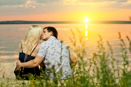 horizontal photo the  happy  couple, outdoor on sunset or sunrise photo