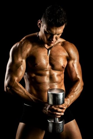 very power athletic guy ,  execute exercise with  dumbbells, on bkack background Stock Photo - 18353041