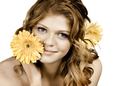 freckled: the very  pretty red-haired blue eyed young woman  with yellow flower,  smile , horizontal close up portrait